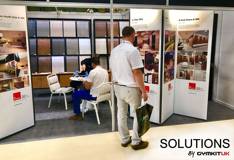 Solutions by Gymkit UK BPFTS stand with visitor looking at previous projects